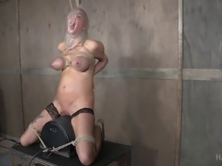 busty blonde slave is tied up and humiliated