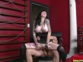 Heavily tattooed mature brunette with huge firm tits gets her tight shaved...