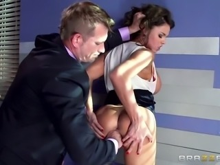 Buxom brunette beauty Peta Jensen gets mouth fucked by horny boss in the office