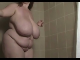 Fat brunette Takes a shower