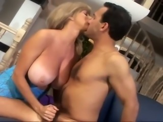 Huge boobed MILF is bouncing her goodies while riding big dick on top