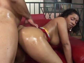 Donna Red is a honey covered in oil ready for a dick