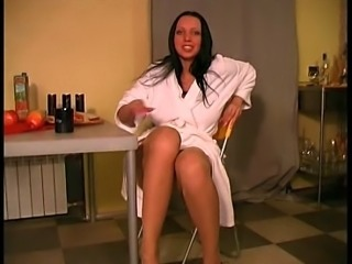 Sassy brunette hottie in bath robe and nylon pantyhose teases camera