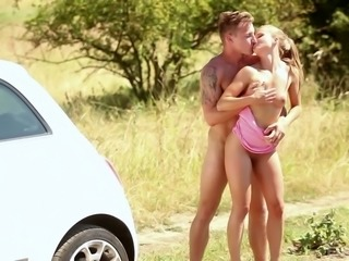 Sexy chick Bella is getting fucked on the hood of her lover's car