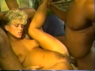 Busty and voracious blondie having fun with two black guys