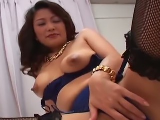 Japanese Marie Sugimoto playfully wanks strong cock of her man