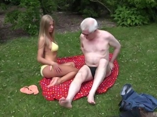 Tanned hoe Lolly Gartner gets fucked from behind in the grass