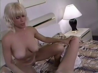 Busty milf and her lean blonde friend in lesbian softcore action