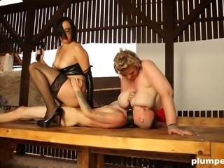 Dominant chubby Diana and Dominika controlling their slave