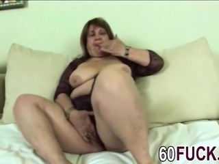 Hot granny is playing with herself before banging