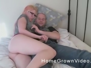 Amateur chick with glasses knows how to make a dick stiff