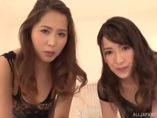 Pair of girls, Tsuno Miho and a friend, satisfying her lucky boyfriend