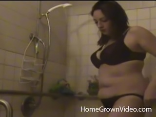 Chubby brunette cowgirl masturbating in the shower with glowing dildo