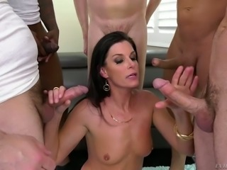 Wild and hot MILF India Summer is surrounded by a group of sex crazed guys