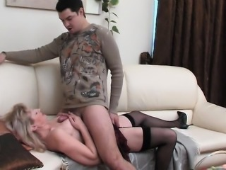 Titjob and blowjob from his mature lover