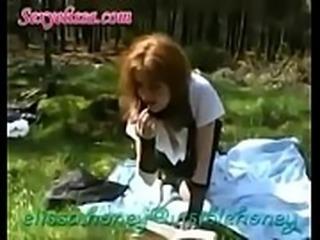 Elissa Honey redhead mature whore in schoolgirl uniform exposes her panties