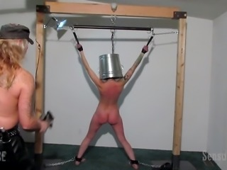 With a bucket on the head and with a bare back, Abigail Dupree feels...