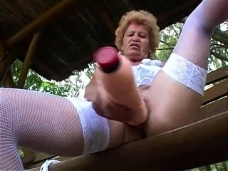 Independent Blonde Girl Toying Outdoor