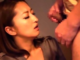 Big breasted Japanese milf jumps on top of a raging cock