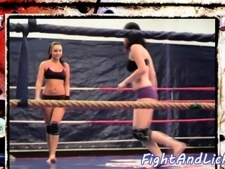 Muscular lesbians wrestling in the boxing ring