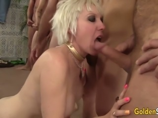 Busty blonde cougar Dalny Marga is so into sucking several cocks at once
