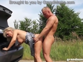 Hot blonde granny seduces and fucks a young stud outdoors