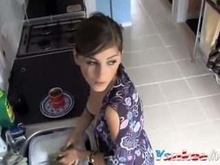 beauty exposed in down blouse while doing the dishes