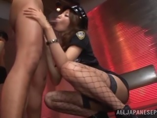 A Japanese mistress in uniform gives two guys blowjobs