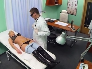 Seductive and very lewd doctor gladly widens her legs
