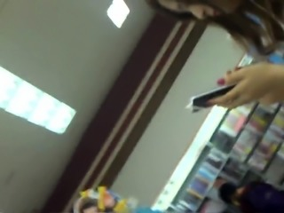 Slender Japanese teen with lovely ass upskirt in the store