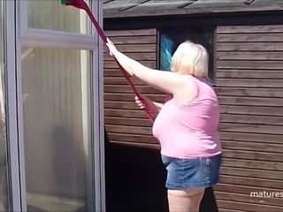 Outside cleaning the windows