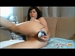 Webcam MILF Shoves A Huge Black Dildo In Her Ass