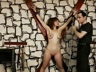 Fellow makes older doxy her bondslave by tit torturing her