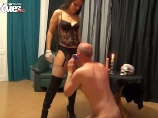 Bodacious mistress fucks bald dude doggy style with a strapon
