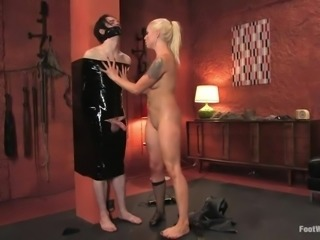 Beautiful blonde milf Lorelei Lee, rubs her foot on her slaves cock, while...
