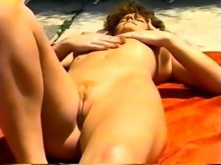 Brunette MILF gives outdoor blowjob
