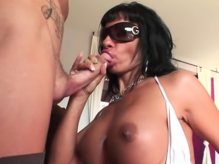 Brunette sweetie plays with a fat cock