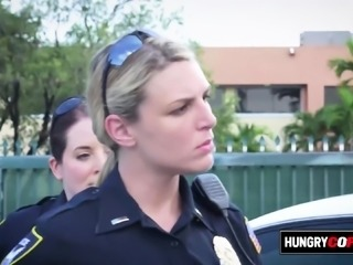 Horny milf cops take suspect out to an alley for hot sex