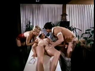Classic porn scene features a lesbian rub and a fuck