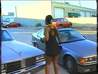 Ebony babe on a car hood  free
